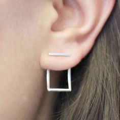 These optical illusion earrings are not what they seem. Though the minimalist shapes appear to pierce through multiple parts of an ear, Otis Jaxon Jewelry has cleverly disguised a more conventional approach. The sterling silver hearts, triangles, and squares are worn like a traditional drop earring—inserted into your lobe piercing—that are then twisted upwards into the appropriate shape.
