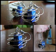Custom made Doctor Who earrings.   The tiny little TARDIS made from polifoam, the spiral is from wire.
