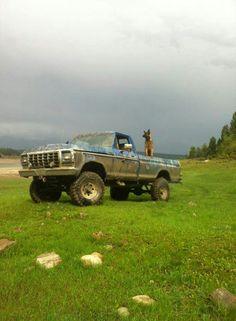 Mud, trucks n a dog