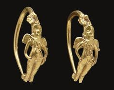 Greek gold earrings, Hellenistic Period, c. 2nd-1st century B.C., featuring a winged Eros, sold for $2,250 at Christie's.