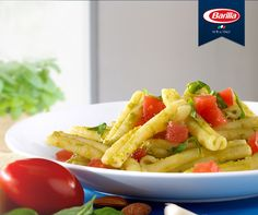 """Barilla® Collezione Casarecce Siciliane with Pesto """"alla Trapanese""""   Casarecce are long twists of pasta, rolled up like a secret scroll. With the lush taste of plum tomatoes, fresh garlic and basil with olive oil, the secret of this recipe is that the sauce will remain trapped in the pasta until the last drop."""