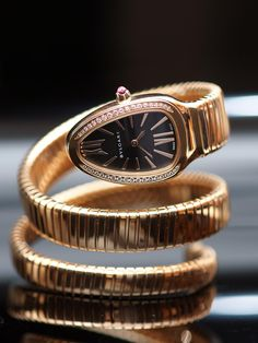 Bvlgari 18k Pink Gold Diamond Serpenti Quartz Watch. 18k Pink Gold Case set with Round Brilliant Cut diamond, Black Opaline Dial on a Two Twirl 18k Pink Gold Bracelet. Features Two Signatures of Bvlgari The Snake Symbol and Tubogas Bracelet.