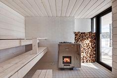 a sauna appliance? Four-Cornered Villa, Avanto Architects, sauna, light gray wood-panelled room with wooden planks