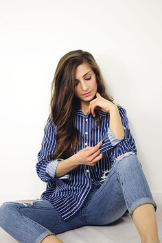 12 Dreadful Dress Pics Woman Wearing Blue And White Striped Dress Shirt And Blue Denim Jeans Sitting On Gray Surface Low Rise Jeans, Outfits Tipps, Blue Pictures, Smart Styles, Dress Picture, Blue Denim Jeans, Shirt Outfit, Dress Shirt, Models