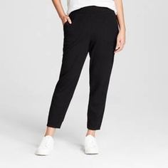 For a chic update to a casual closet staple, add the Jogger Pants from A New Day™ to your wardrobe. These mid-rise pants keep things comfortable, while the elastic at the cuffs lets you customize your look. Pair with a graphic tee and low-top sneakers for a cozy look that's comfy enough to wear at home and cute enough to run errands in.