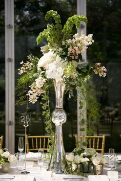 Latour Trumpet Vase with Greenery   Article: Tall Flower Arrangements to Inspire Your Wedding Centerpieces   Photography: Lauren B Photography   Read More:  http://www.insideweddings.com/news/planning-design/tall-flower-arrangements-to-inspire-your-wedding-centerpieces/2484/