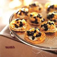 A recipe for the perfect little bite! Tortilla Chips with Black Beans, Corn and Spicy Cilantro Cream