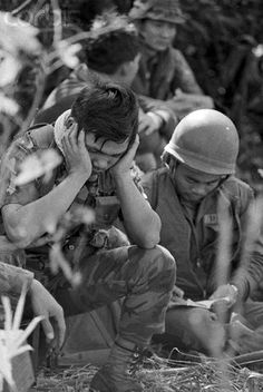February 1971, Khe Sanh, South Vietnam. In this Kent Potter photograph, an unhappy looking South Vietnamese soldier waits February 8th at Khe Sanh to be air lifted into Laos where front dispatches indicate sharp clashes between government troops and North Vietnamese and Pathet Lao forces. The commander of South Vietnamese forces in Laos said on February 14th that his troops are prepared to stay there until the Ho Chi Minh Trail is shattered.  Image by © Bettmann/CORBIS