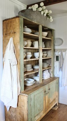 Green vintage kitchen cupboard and ironstone white china in Canadian Rustic Farmhouse