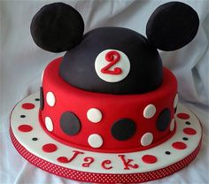 Small 2 tier Mickey Mouse Cake : Yellow cake. Covered in Vanilla buttercream and decorated in fondant.