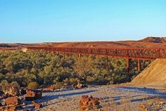 Algebuckina: A siding ruin near the Neales River with a permanent waterhole east of the track. One of the most impressive bridges (1889) on the old line is across the river. It is 12 metres above the river and at 578m in length, is the longest bridge ever built in South Australia. Australia Living, South Australia, Western Australia, Desert Trip, Us Deserts, Red Centre, Ruin, Bridges, Touring