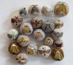 Moths embroidered on felt balls....Mothballs!
