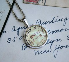 New York City Vintage Postmark necklace, by CrowBiz on Etsy.  More cities available!