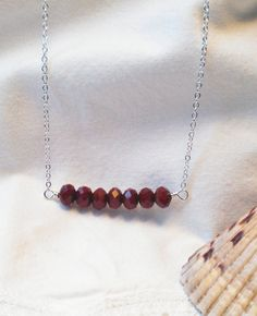 Dark Red Faceted Crystal Rondelle Necklace Wire Wrapped Jewelry Handmade Wire Wrapped Jewelry. $20.00, via Etsy.