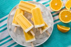 Orange Cream Popsicles are rich, sweet, tangy, and creamy and a throwback to an old childhood favorite using McCormick Pure Vanilla Extract. Fudge Popsicle Recipe, Healthy Popsicle Recipes, Healthy Popsicles, Homemade Popsicles, Chocolate Pops, Frozen Hot Chocolate, Yummy Ice Cream, Homemade Ice Cream, Frozen Desserts