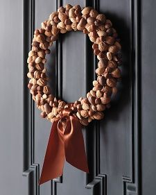 Nuts in varied shapes and shades make a welcoming wreath.  DIY from Martha Stewart.