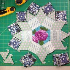 So far the centre rosette is complete and I have cut out the fabric ...