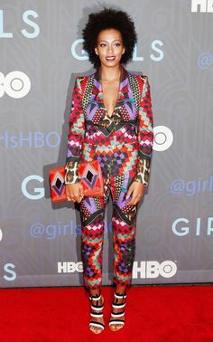 Solange wears a statement-making printed suit by Just Cavalli and a graphic clutch
