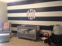 Navy and White Striped Accent Wall - super-preppy in a modern baby nursery!