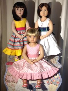 """AGFAT Dolls and a Kidz N Cats girl all wearing a version of the Swish and Swirl """"Parisienne"""" dress."""
