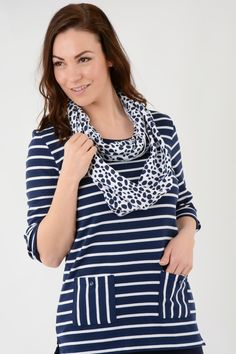 TU20020 Stripe tunic top with pockets and scarf. 2 front patch pockets. This chic style tunic is the perfect item for this season. The contrast between the two prints adds a little extra to the garment. Pair with our casual trouser. Available in Denim White and Emerald White. Approx. Length 70cm. 65% Polyester 35% Cotton. Machine washable.