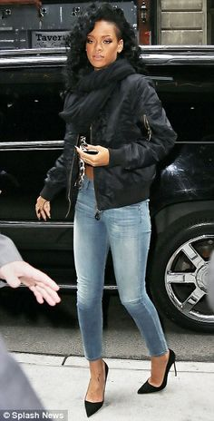 Fashion fan: Rihanna, pictured in a midriff in New York last week...Rihanna is designing for ARMANI...what great news!