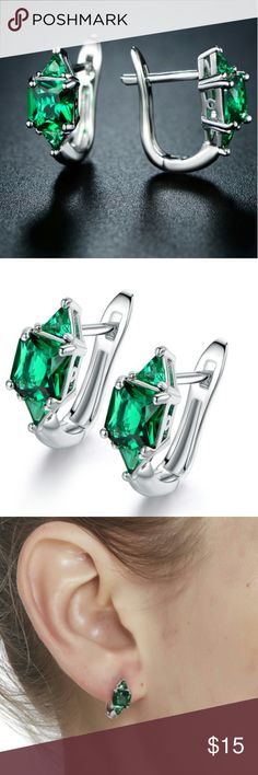 Classy Faux emerald white gold huggie earrings Faux emerald white gold huggie earrings Nwot, still in the original packaging Very classy! Gorgeous emerald color! Jewelry Earrings