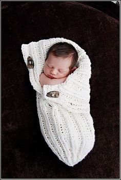Button-Up Baby Wrap pattern (this is a free knitting pattern, but it looks easy enough to replicate in crochet)