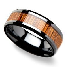 An inlay of reused teak wood adorns this 8-millimeter black ceramic men's band with polished bevels.