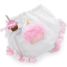 These adorable bloomers are perfect for under her first birthday dress. They feature pink polka dot ruffles on the leg openings and a pink chiffon-ruffled cupcake with a birthday candle. Elastic waistband assures a snug fit.