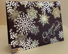 Using the 'Sparkling Christmas' StampTV Kit. White snowflakes have been done using the dies included in the kit. The other snowflakes were embossed with 'platinum glitter' powder. Card base is Edible Eggplant.