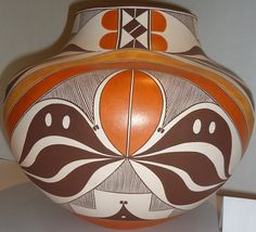 Native American Acoma Poly-chrome Pottery Olla, By Dolores J. Aragon 848. Description: Native American Acoma Pottery Olla by Dolores .J. Aragon. Four color; stylized flower, seed and geometric design;