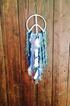 Hey, I found this really awesome Etsy listing at https://www.etsy.com/listing/228289008/peace-sign-dream-catcher-white-leather