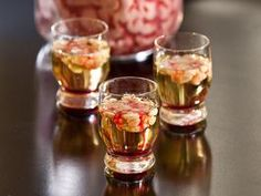 Channel your inner mad scientist to create this Bloody Brain Shooter. Mixing acidic lime juice and Irish cream causes the cream to curdle, creating brain-like strands in the shot!