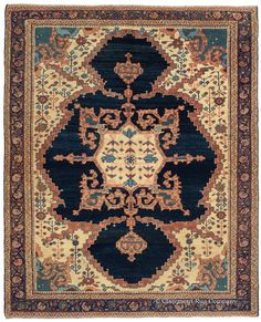 """Bakshaish """"Dragon and Phoenix,"""" 4ft 5in x 5ft 4in, 3rd Quarter, 19th Century. Of great significance as a collector's piece, this entirely unique Northwest Persian rug belongs to the rare group of antique Bakshaish carpets depicting the mythical Dragon and Phoenix forms. Its deeply saturated and subtly abrashed (intentional color striation) indigo blue supplies the backdrop for the oversized animal skin medallion and its dramatic saw-toothed swirling dragon motif offshoots."""