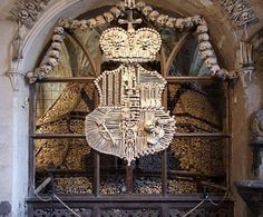 For the macabre -- crest and crown made entirely of bones. In 1870, monks in a village outside Prague hired woodcarver Frantisek Rint to decorate their church with human bones. The most extravagant piece, an 8' long chandelier ringed with skulls, containing at least one of every bone in the human body. Aptly named, The Church Adorned With the Bones of 40,000 Corpses. eeew...