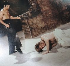"""Man down! Chuck Norris takes a beating from Bruce Lee in """"Way of the Dragon""""."""