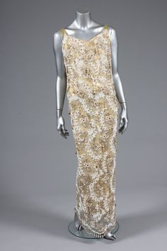 Ramon Valera cloth of gold and white lace evening gown or `Terno', Philippines, the columnar gown embellished overall with gold elliptical beads, white seed beads and pearl droplets to the hem, with matching gold shoes Ramones, Lace Evening Gowns, Historical Dress, Couture Details, Gold Shoes, Costume Dress, Filipino, White Lace, Seed Beads