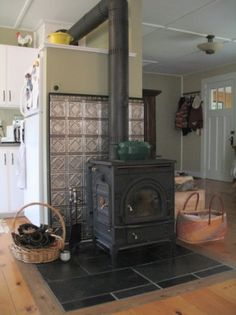 We would love to have a wood stove in our kitchen. They used tin ceiling tiles as heat shield for wood stove or pellet stove. Maybe this would be a way for me to incorporate tin tiles. Wood Stove Surround, Wood Stove Hearth, Stove Fireplace, Wood Burner, Wood Stove Heat Shield, Wood Stove Wall, Fireplace Hearth, Tin Walls, Tin Ceiling Tiles