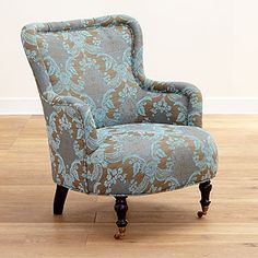 I love the colors in the chair. It looks so comfy you'll want to curl up with a blanket and read a book.