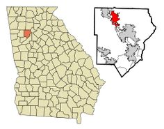 Kennesaw, Georgia  The city is perhaps best known nationally for its mandatory gun-possession law.