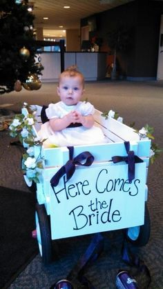 Wedding flower girl wagon for a very young flower girl. Decorate with flowers and bows. Wagon For Wedding, Baby Wedding, Our Wedding, Dream Wedding, Spring Wedding, Wedding Ceremony, Wedding Flower Photos, Wedding Pics, Wedding Flowers