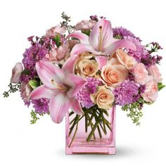 Can't decide on one type of flower for Mother's Day? Get your mom this mix of peach roses, pink asiatic lilies, pink carnations, lavender cushion mums, and lavender waxflowers to brighten up her day.