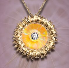 Our beautiful Sunflower Illusia pendant in 14k yellow gold with diamonds and (unseen) yellow opal. Style A15.