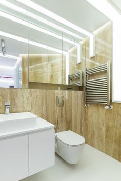 minimalist bathroom, natural stone walls, white matte MDF cabinet, hidden wall storages with mirrored fronts orders/price offers at: office Minimalist Apartment, Minimalist Bathroom, Natural Stone Wall, Natural Stones, Mdf Cabinets, Stone Walls, Wall Storage, Marsala, Design