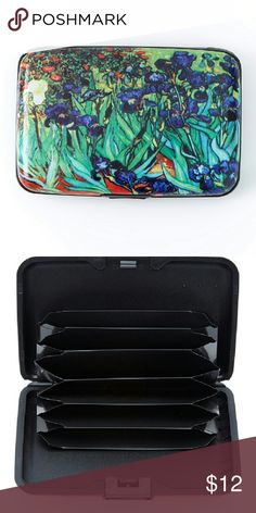 """Green and blue flower irises armored wallet Keep your essentials organized and protected with this trendy wallet featuring an RFID shield and electromagnetic sleeve that Safeguard your personal information. 4.5 """" wide x 3 """" High X .5. """"deep. Metal. Snap closure. Standard wallet pockets. Bags Wallets"""