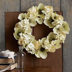 Paper Flower Wreath - Pale Green #WestElm -  an easy, timeless and fresh alternative to dried or silk flowers to freshen up a space.