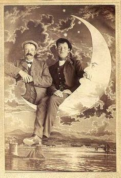 Vintage paper moon arcade photo with scenic background. The moon appears very dapper with a long moustache.