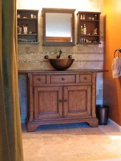 Copper Vessel Sink with Wall Mount Cross Handle Faucet, installed on a wood vanity.