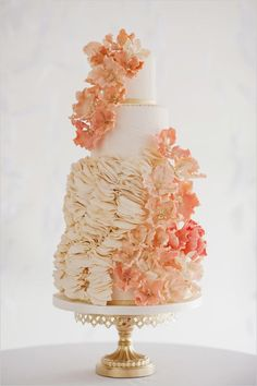 Peach, gold and white cake with ruffles and peonies